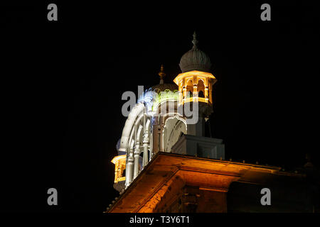 Architectural detail of multi coloured illuminated roofs in the Golden Temple of Amritsar at night, the holiest pilgrimage site of Sikhism, Amritsar - Stock Image