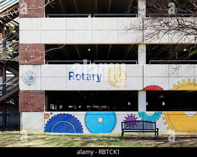 Decorative sign or signage on side of parking garage or car park advertising and marketing for the Rotary Club in Montgomery Alabama, USA. - Stock Image