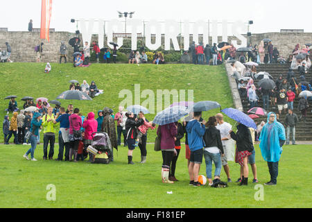 Portsmouth, UK. 29th August 2015. Victorious Festival - Saturday. Braving the rain at the Victorious Festival. Credit: - Stock Image