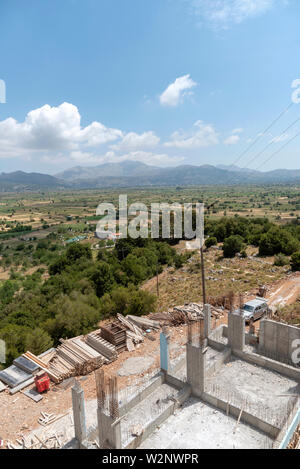 Crete, Greece. June 2019. Building works using recyled wooden planks. Overlooking Lassithi Plateau, Crete, Greece - Stock Image