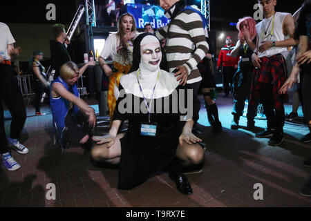 A figure in a nun's habit during an evening event on 19th edition of the Pyrkon Fantasy Festival, which took place on April 26-28, 2019 at the Interna - Stock Image