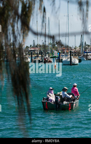 People fishing from a boat at Mooloolaba in Queensland. - Stock Image