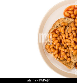 Traditional Snack of Baked Beans on Toast Served on a Plate - Stock Image