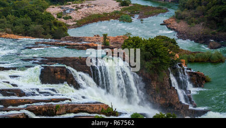 Hartebees Poort dam outside Pretoria, South Africa overflowing into the river. - Stock Image