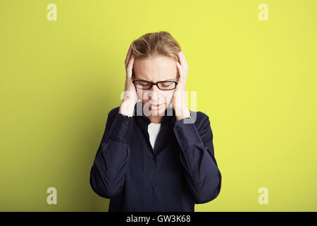 Portrait Handsome Pretty Young Woman Who Grabs Her Head Hands Headache.Empty Yellow Background.Beauty,Shock,Fashion - Stock Image