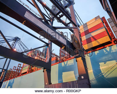 Low angle view of cargo ship at Port of Felixstowe, England - Stock Image