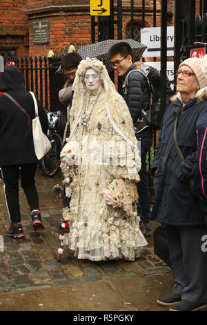 Rochester, Kent, UK - 1st December 2018: A woman dressed as a character from the Dickensian era participates in the main parade on Rochester High Street. in Hundreds of people attended the Dickensian Festival in Rochester on 1 December 2018 The festival's main parade has participants in Victorian period costume from the Dickensian age. The town and area was the setting of many of Charles Dickens novels and is the setting to two annual festivals in his honor. Photos: David Mbiyu/ Alamy Live News - Stock Image