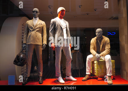 Clothes manequins in shop window in London UK - Stock Image