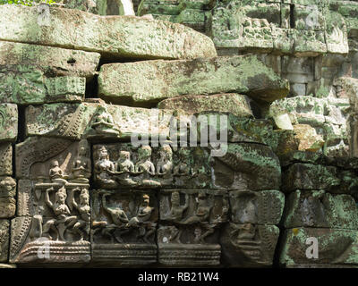 Decoration on wall of ruins of Ta Prohm modern name of Angkor temple Siem Reap Province Cambodia, built in the Bayon style in  1186 A.D Buddhist templ - Stock Image