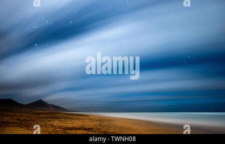 Night picture with long exposure and night star in movement - beach and mountains beautiful wild landscape for travel adventurer and alternative vacat - Stock Image