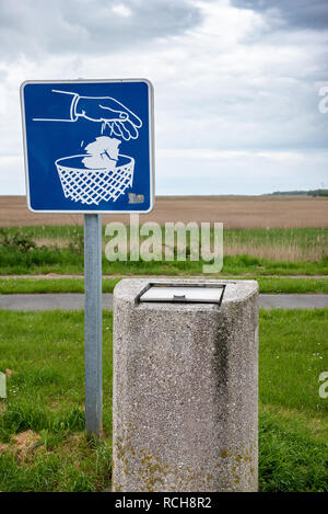 Trash and panel for the preservation of the environment - Stock Image