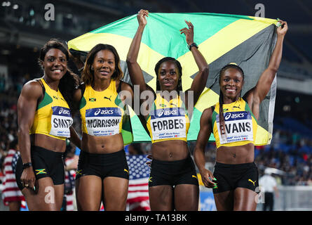 YOKOHAMA, JAPAN - MAY 12: Jonielle Smith, Natasha Morrison, Shashalee Forbes and Gayon Evans of Jamaica after they finished 2nd in the women's 4x100m relay final during Day 2 of the 2019 IAAF World Relay Championships at the Nissan Stadium on Sunday May 12, 2019 in Yokohama, Japan. (Photo by Roger Sedres for the IAAF) - Stock Image