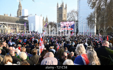 London, UK. 29th Mar, 2019. Thousands of Pro Brexit supporters join the Brexiteers Rally in Parliament Square London today as they show their anger at not leaving the EU today causing traffic chaos in the city . MP's are sitting today to debate leaving the European Parliament on the day it was originally supposed to happen Credit: Simon Dack/Alamy Live News - Stock Image