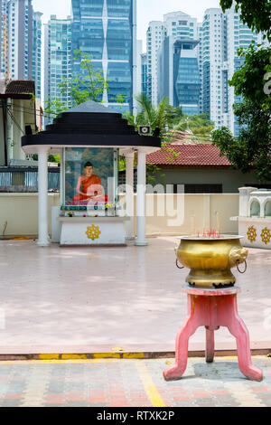 Buddhist Shrine and Incense, Maha Vihara Buddhist Temple, Kuala Lumpur, Malaysia. - Stock Image