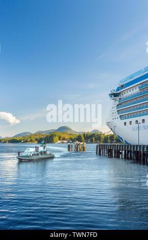 Sept. 17, 2018 - Ketchikan, AK: Sea Otter Express returing to port alongside docked Island Princess cruise ship, late afternoon. - Stock Image