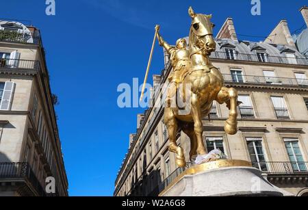 Gilded bronze equestrian statue 1874, depicting Saint Jeanne d Arc Joan of Arc . Place des Pyramides, Paris. - Stock Image