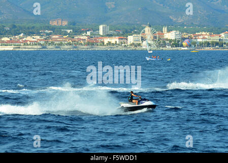 Jet skis and power boats in the sea near St. Raphael, France. - Stock Image