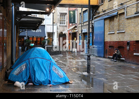 Tent belonging to homeless person in Theatre land in Central London, England, UK - Stock Image