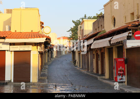 deserted pedestrian street in the old town of Rhodes, Greece at sunrise - Stock Image
