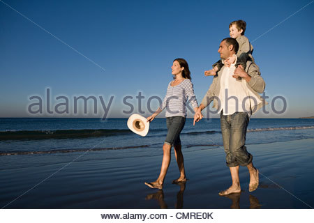 Family walking on the beach - Stock Image