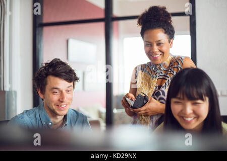 Coworkers smiling - Stock Image