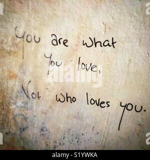 Quotes on a public wall about love and self awareness - Stock Image