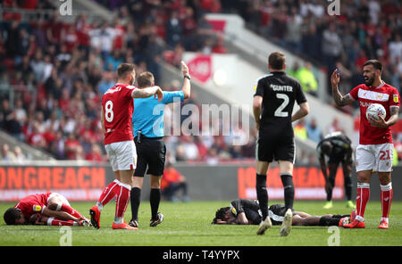 Bristol City's Korey Smith (left) lies injured after clashing with Reading's Ovie Ejaria (right) before being stretchered off during the Sky Bet Championship match at Ashton Gate Stadium, Bristol. - Stock Image
