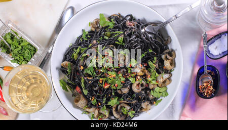 Top down view of Italian black pasta with squids (cuttlefish) and ink - Stock Image
