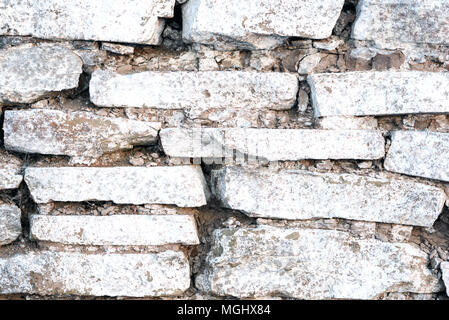 Old stacked tile wall with white wash paint in an old worn state - Stock Image