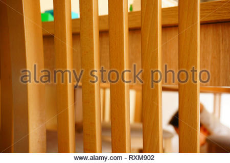 Close up of a wooden chair back. - Stock Image
