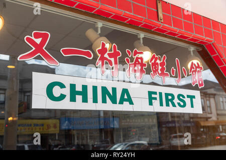 'China First', sign on window of Chinese restaurant; Clement Street, San Francisco, California, USA - Stock Image