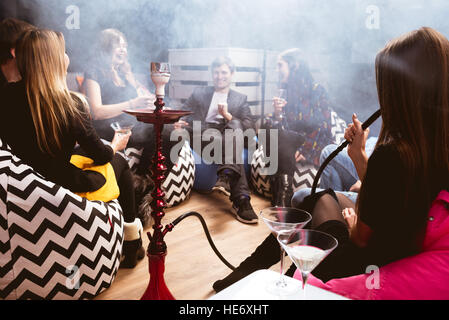 Group friends club bar shisha - Stock Image