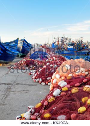 Morocco, Marrakesh-Safi (Marrakesh-Tensift-El Haouz) region, Essaouira. Fishing nets and boats in the fishing port. - Stock Image