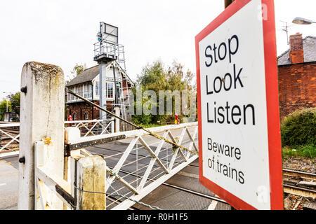 Heckington level crossing, stop look listen sign at level crossing, level crossing stop look listen sign, train warning sign, Heckington train sign - Stock Image