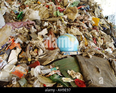 Symbol picture The world sinks in the garbage - Stock Image