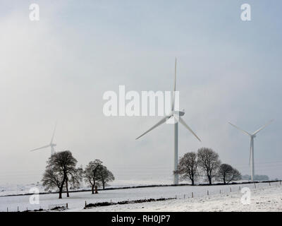 Brassington, Derbyshire. 31st Jan 2019. UK Weather: UK Weather: wind turbines in the snow on a very cold winter day, Brassington, Harborough Rocks & the High Peak Trail, Derbyshire, Peak District National Park Credit: Doug Blane/Alamy Live News - Stock Image