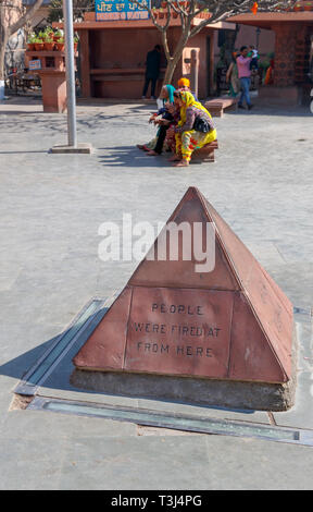 Marker where shots were fired, Jallianwala Bagh, a public garden in Amritsar, Punjab, India, commemorating the British Jallianwala Bagh Massacre and shooting - Stock Image