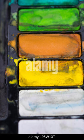 Artist's paint palette of assorted watercolours - Stock Image