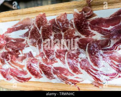 Dish of tipical spanish ham, jamon iberico. Spanish jamon iberico. Barcelona, Spain - Stock Image