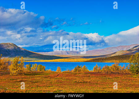 Bright autumn day at the shore of lake Torneträsk in Swedish Lapland. - Stock Image