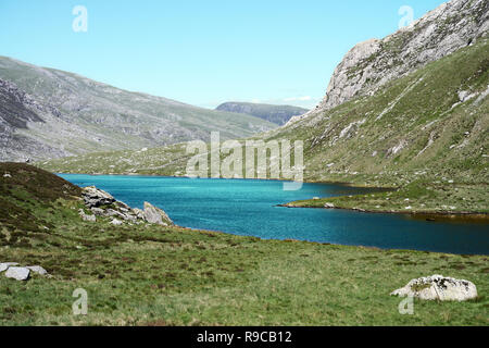 Cwm Idwal is a cirque (or corrie) in the Glyderau Range of the Snowdonia National Park. Here the green water of lake (Llyn Idwal) has been enhanced. - Stock Image