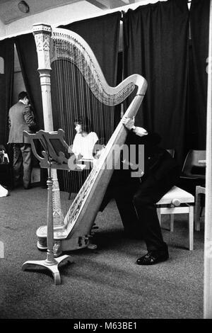 Concert harp on stage at small eisteddfod in village hall Talsarnau Gwynedd Wales UK - Stock Image