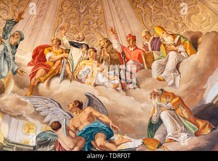 COMO, ITALY - MAY 8, 2015: The fresco of Glory of holy men as part of Glory of Christ the King fresco in church Santuario del Santissimo Crocifisso. - Stock Image