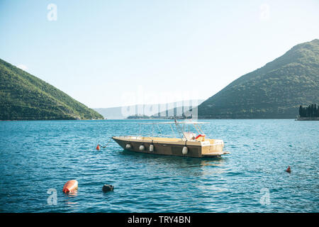 Beautiful view of the boat in the sea against the mountains. Natural landscape or horizon. Sea transport. - Stock Image