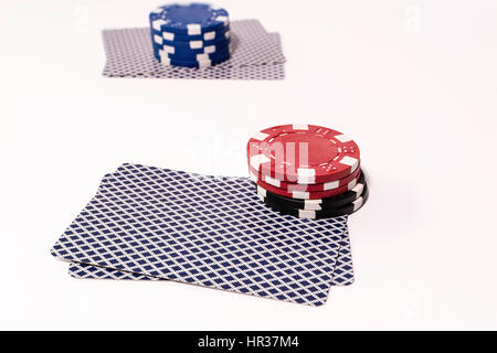 Two hands of Texas Holdem Poker with betting chips - Stock Image