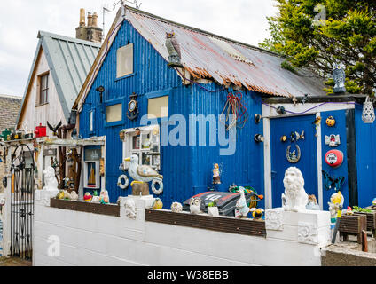 Quikry unsuual sheds converted to houses with ornaments, Footdee, Aberdeen harbour, Scotland, UK - Stock Image