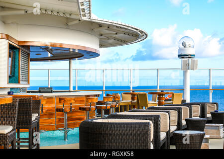 A bar lounge on the upper deck of a cruise ship at sea. - Stock Image