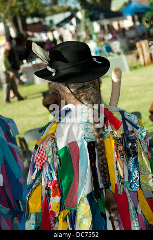 Female Morris Dancer, view from behind, long hair in a plait. - Stock Image