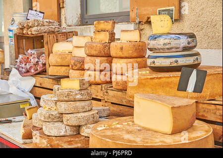 Stall selling cheese at the weekly market in the town of Lamastre, Ardeche, Rhone Alps region of France - Stock Image