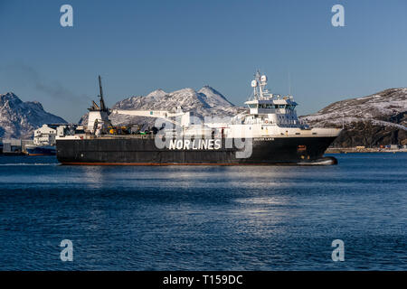 The Cargo Ship Silver Lake, operating under the flag of The Faroe Islands, sailing through the Norwegian Fjords during winter. - Stock Image